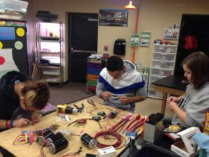 Felicia Butler, Cesar Morales and Rachel Blackburn are working on parts for First Robotics