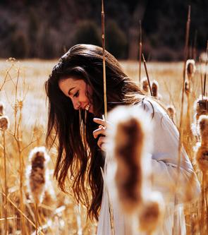 A girl in a bright wheat field
