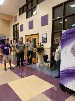 Board Members Try Out New FHS Vending Machine