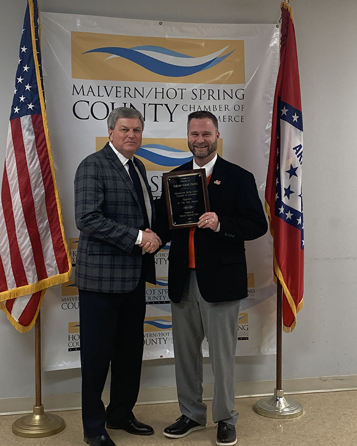 MNB President Mark Roberts presents Business of the Year award to Brian Golden