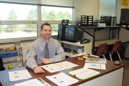 Mr. Rolfs at his desk