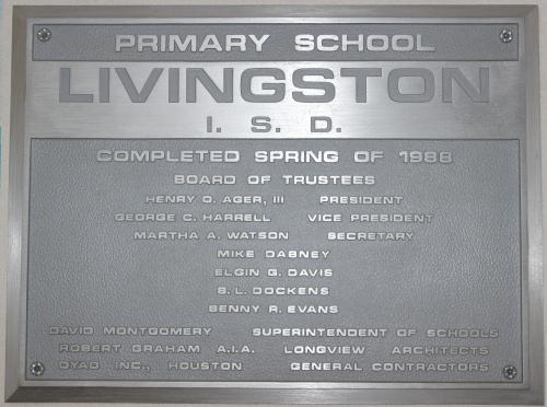Plaque inside Pine Ridge Elementary with details about the school board at the time of building