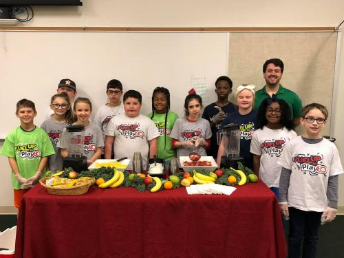Students from 4th and 5th grade visit SHAC to discuss nutrition and make smoothies