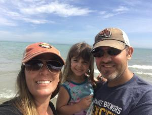 Momma, Daddy, and Isabella at the beach near Milwaukee, WI