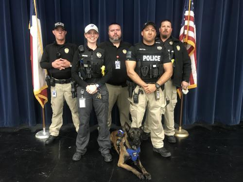 Back row from left to right Officer Jeffrey Carroll, Officer Matt Essary, K9 Officer Sean Royalty Front row from left to right Chief Laci Jo Brimer, Officer Antonio Britton and  Bottom Officer Rocko