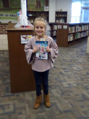 First student to check out a new library book!