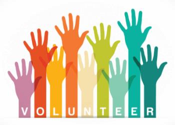 Volunteer with hands raised