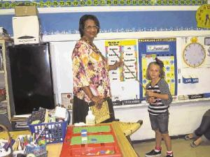 Mrs. Allen and Audrey Fuller when she was in 1st Grade.