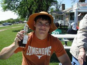 Bo hoisting a bottle of root beer at Ft. Washita