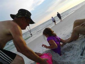 My Dad, burying my daughter in the sand