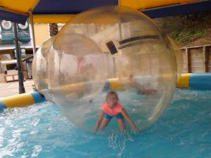 Kai Leigh in the hamster ball at Destin