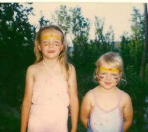 My sister and me with our faces painted as Wonder Woman at the River Fest!!