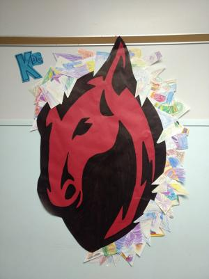 With white scrap paper, each kindergarten student colored/ designed a shape which all together formed the mane of our Colt!