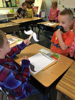 Kindergarten students learning their sight words.