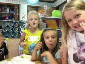 Kindergarten students enjoying some apples.