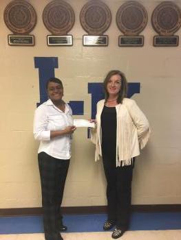 Kellie Cox presenting Elementary Principal, Shekita Martin with the $500 check.