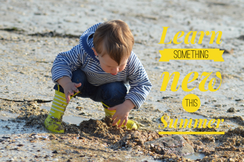 young boy playing in sand; Learn something new this summer