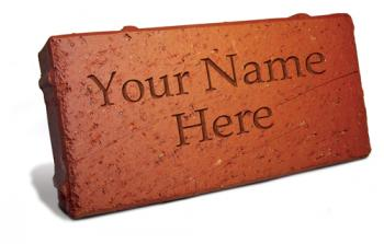 image of red brick with the words Your Name Here printed in the center