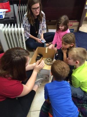 Easter activity with the Pre-K.  Students are learning about baby chicks.