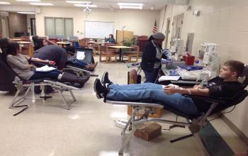 HOSA students give blood.