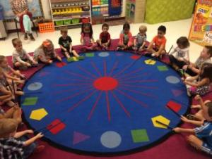 PreK playing rhythm sticks