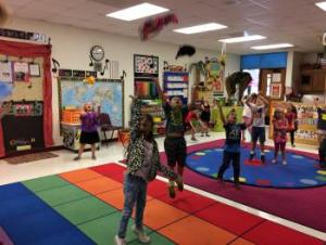 K students moving with scarves