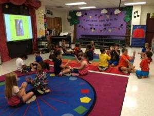 2nd graders creating partner clap patterns to pop music of Michael Jackson