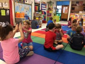 2nd grade partner claps with pop music