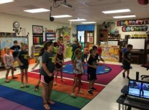 2nd graders learning dance moves with Cupid Shuffle