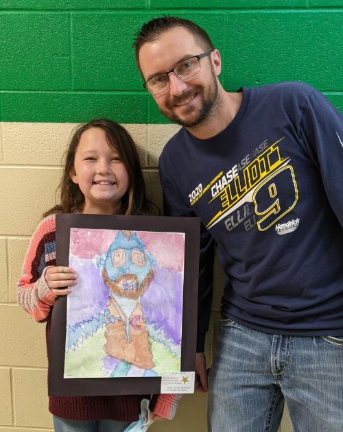 Picasso style portrait of art teacher by third grader