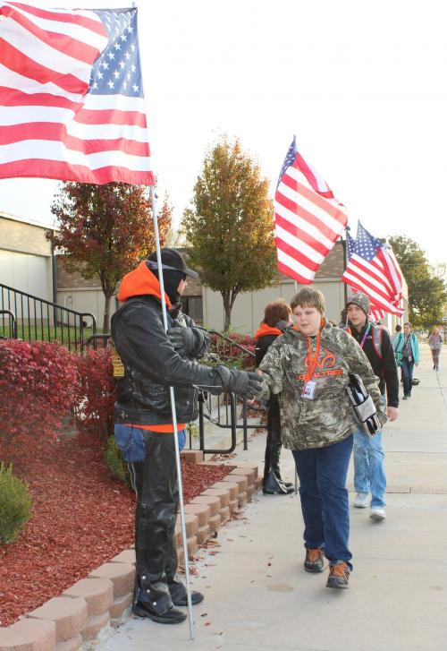 RMS students shake veterans hands outside the school