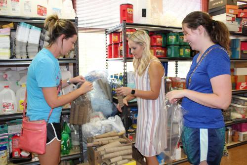 teachers pick up supplies in teacher room