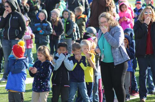 first graders crunch into farm fresh apple