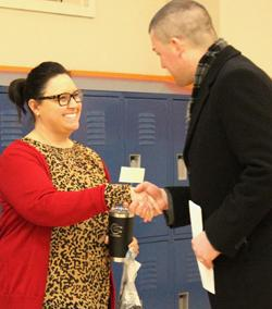 kellen gives award to angie wright
