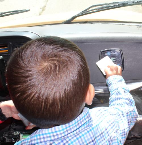 Preschooler swipes Zonar card as he boards the school bus