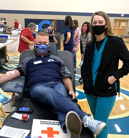 HOSA students help peers through blood donor process