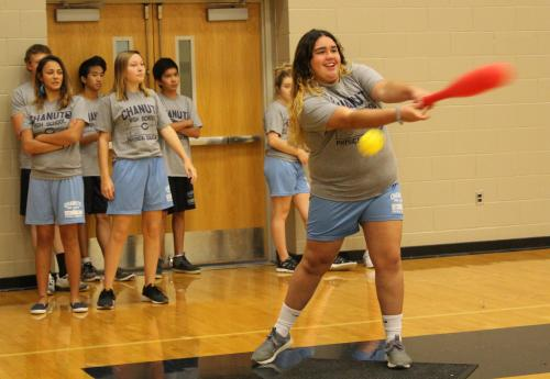 CHS girls takes a swing during wiffle ball in PE class