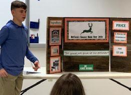 boy shows entrepreneur project to judges