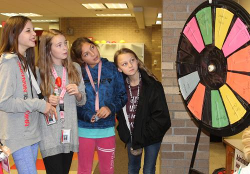 RMS students spin wheel of fortune for adopt a child