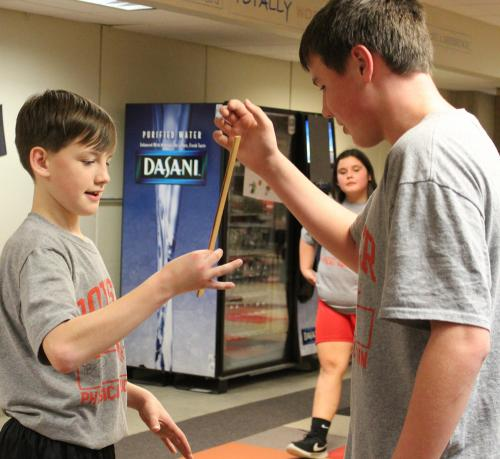 boys test reflexes with ruler drop