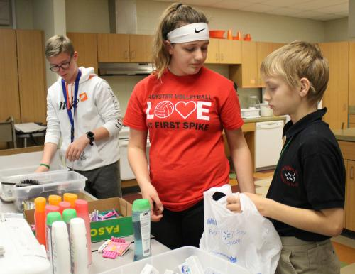rms students fill sacks with hygiene products