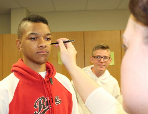 FCCLA teacher adds black line to student's face to symbolize abuse