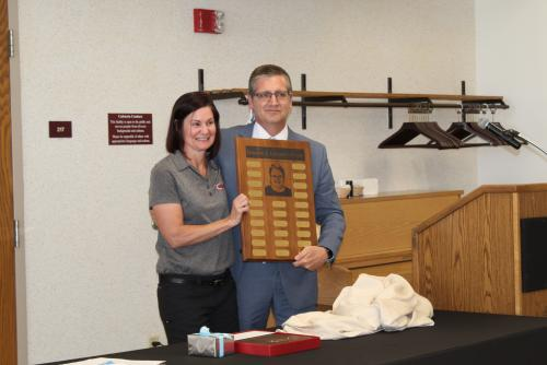 Teri Lund receives Cummings Award from Superintendent Richard Proffitt