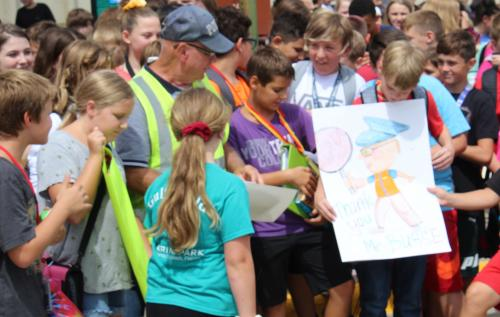 students present poster to crossing guard