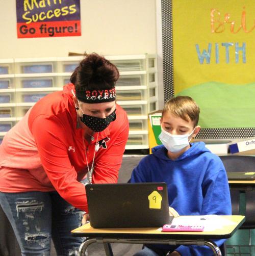 Math teacher Molly Smith helps student