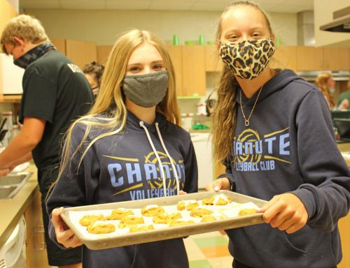 Girls show off cookies revised  from a 1940s recipe