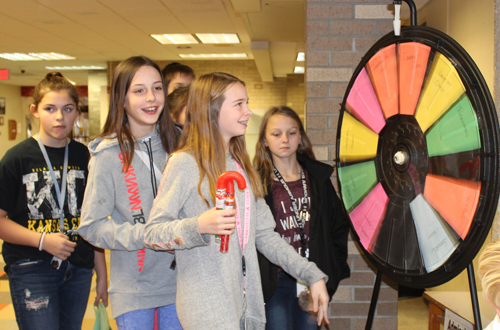 Spinning wheel of fortune to raise money for adopt-a-child program