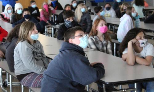 students listen to author