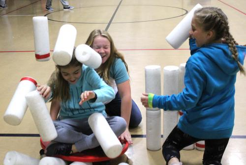 CES students roll on scooters through stacks of Styrofoam 'bones'