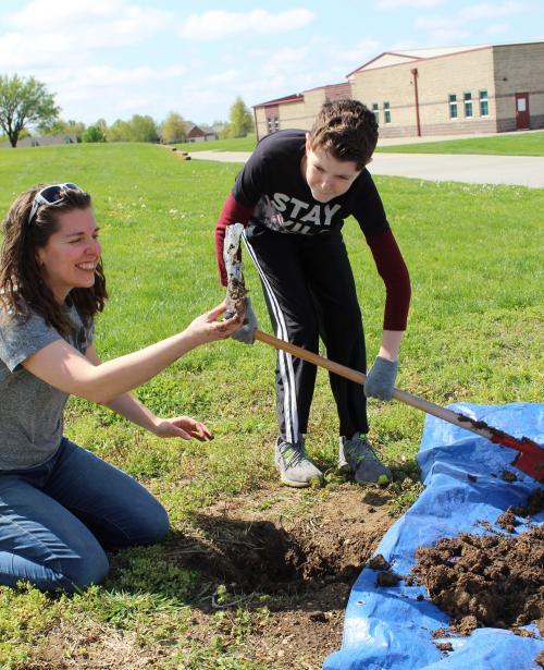 teacher digs up buried water bottle